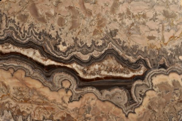 A picture of cream-coloured marble, with dark-blue coloured swirls down the middle of the slab